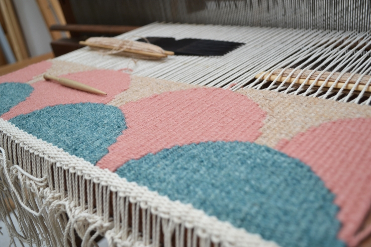 The weaving process in action at Christy's studio