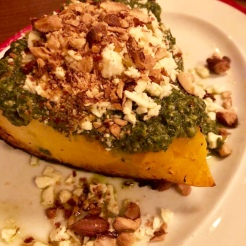 Roasted pumpkin wedge with pesto, feta and nuts